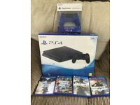 PS4 with 4 games and 2 controllers.