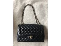 Chanel single flap jumbo bag in black lambskin - great condition, authenticity card, dust bag!