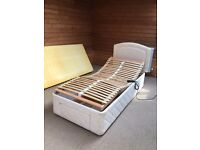 A single electric profiling bed with a memory foam matress and removable matress cover