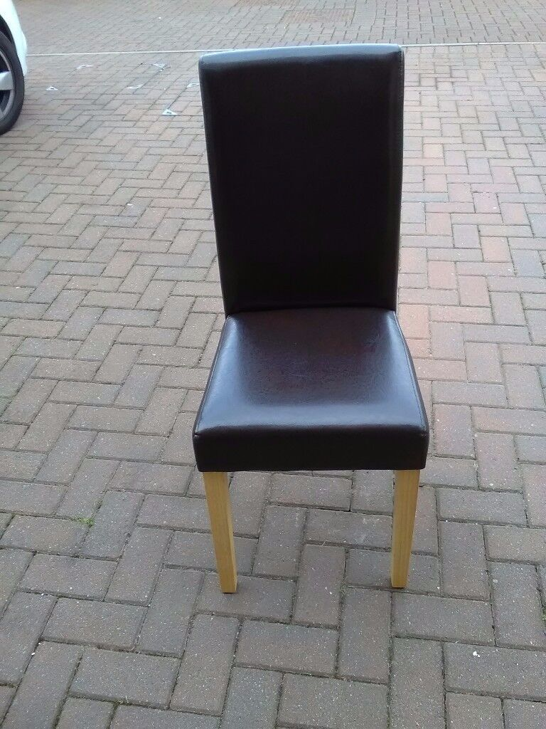 4 brown faux dinning chairs