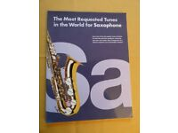 Selection of alto saxophone music books containing popular and well-known pieces.