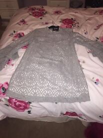 Gorgeous grey stylish dress,size 14. Never wore, excellent condition. Bought for £30.00