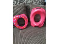 2 pink toilet training seats