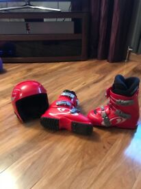 Ski boots and ski helmet