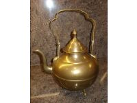 brass kettle and brass cup/vase on coaster