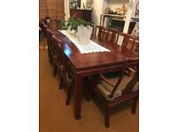 Rosewood dining table and 10 chairs