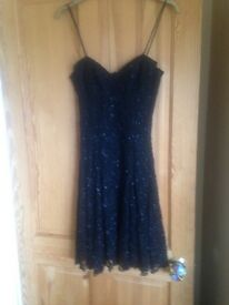 Beaded black dress! Possibly now a size 12 it was altered by a tailor
