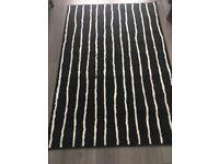 Ikea black and white stripe rug.