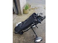 Full set of clubs, complete with bag, trolley, brolley and balls.