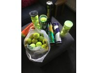 Over 30 tennis balls, some new. Perhaps for doggies?