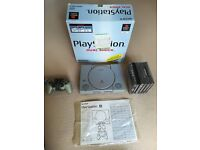 PlayStation 1 boxed with one analogue controller and games