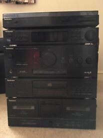 Technics stereo system including CD, tuner,twin tape deck and turntable