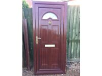 Rosewood coloured external door and frame, with handles, letter box, lock and keys