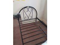 Single metal bed frame.