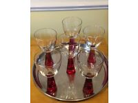 6 glasses with solid red stems