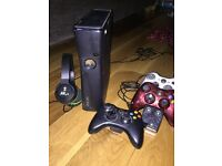 X Box 360 console, 3 controllers, charger and 21 games