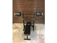 Weight training bench with weights