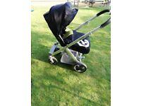 Babystyle oyster pram with carry coat amd footmuff.