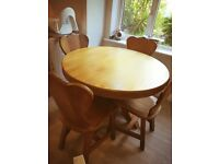 Solid oak round table with 4 unusual shaped chairs