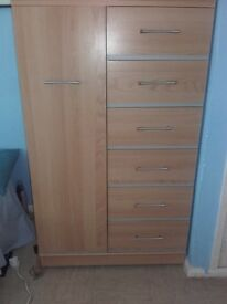 wardrobe with hanging space and six drawers