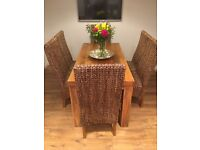 Mango solid wood dining table and 6 high back rattan chairs