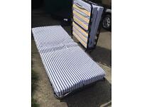 Two fold away portable beds