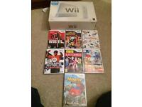 Boxed Nintendo white Wii and games