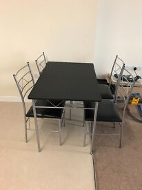 Brand new table and chairs.