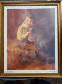 Framed picture of boy and pet rabbit