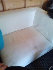 Faux leather corner chair. Off white.. Free standing. Nice comfy good sized chair.