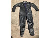 Men's black one-piece motorbike leathers