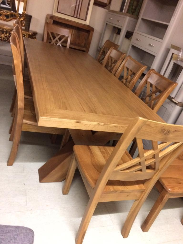 Large solid oak table £550 new chairs £80 each