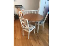 Circular dining table with 3 chairs for sale