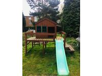 Elevated play house with slide for sale.