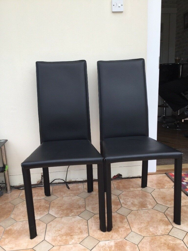 Black leather dining chairs good condition
