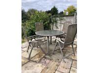 Round garden table and 4 reclining chairs