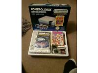 Perfectly boxed Nintendo entertainment system (nes) with 2 pads all the inserts and Dr Mario