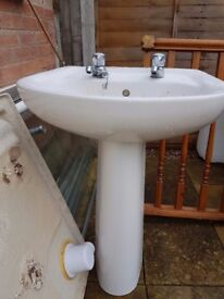 Complete bathroom sink with taps and stand
