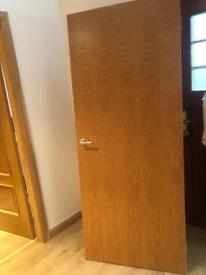 Solid oak internal door with chrome handle