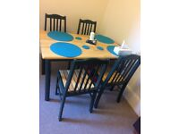 Wooden dinning table with 4chairs for sale in excellent condition