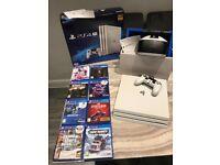 White PlayStation 4 Pro 1TB PLUS VR Headset PLUS games bundle
