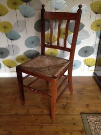 Pretty wooden chair with basket weave seat
