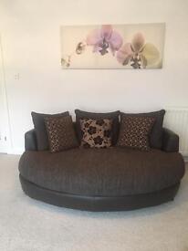 Lovely modern cuddler sofa leather & fabric