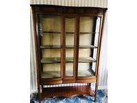 Bow fronted China cabinet, made from wood and glass