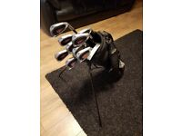 Pinseeker voodoo set of iron golf clubs, putter and stand bag