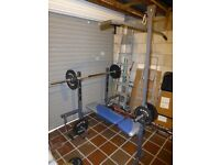 York 521 weight bench with attachments and 150kg of weights.