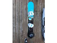 159 Woman's snowboard, Bindings, smiths helmet, snowboard bag and waxing kit.