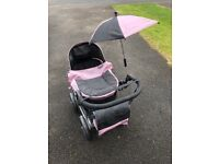 Silver Cross toy pram, parasol and changing bag. Excellent condition. Folds down for easy storage.