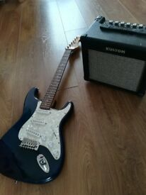 Encore electric guitar and Kustom amp