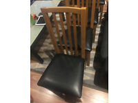 Dining table with 4 chairs. Solid wood; table unfolds (originally from Debenhams)